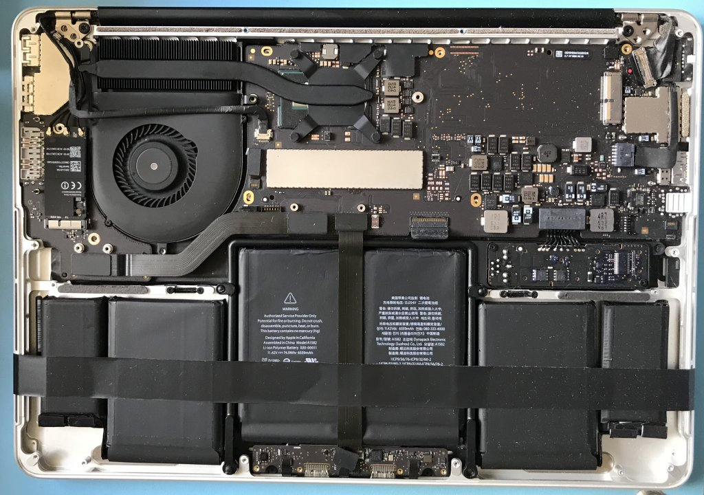 Apple MacBook with cover removed