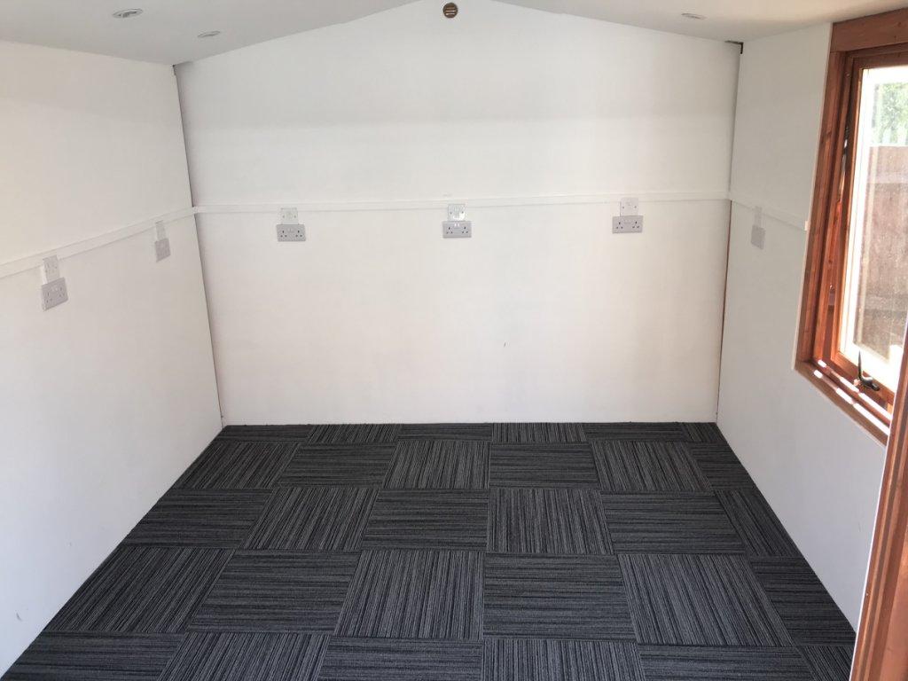 Workshop with carpet laid